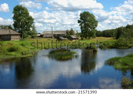 A north russian village by the river, near the wood, green grass, blue sky, reflections on the water