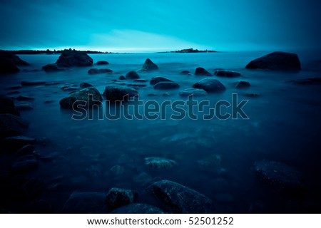 A northern shoreline on a cold spring morning in may - stock photo
