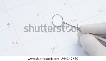 A note of a dentist appointment on a calendar, dental check up - stock photo