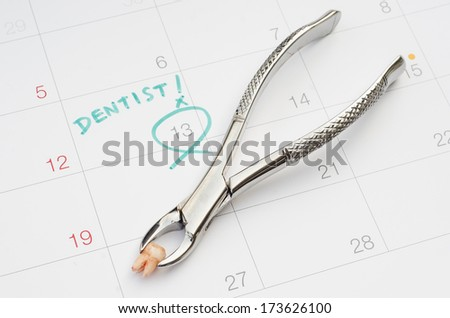 A note of a dentist appointment on a calendar, extraction of tooth - stock photo