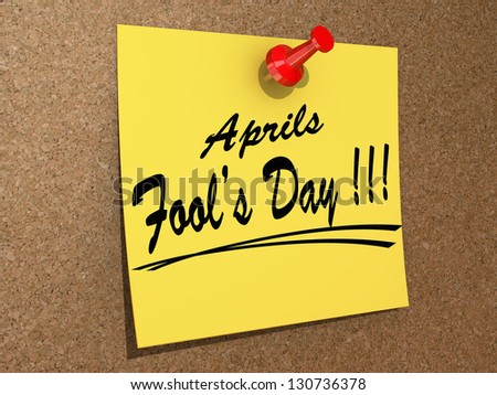 "A note pinned to a cork board with the text ""Aprils Fool's Day"" - stock photo"