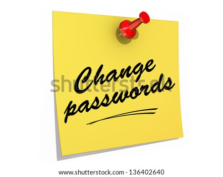 A note pinned to a white background with the text Change Passwords. - stock photo
