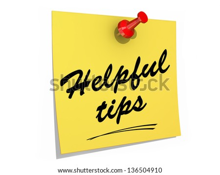 A note pinned to a white background with the text Helpful Tips. - stock photo
