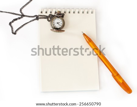 A notepad with a bright pen and a chain watch on a white background with a place for text - stock photo