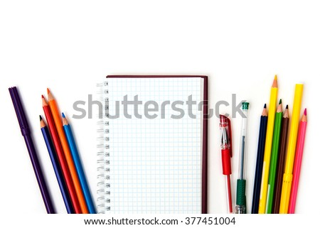 a Notepad with a pen on a white background - stock photo