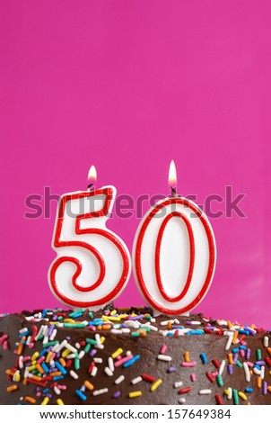 A number candle is lit in celebration of fifty years. - stock photo