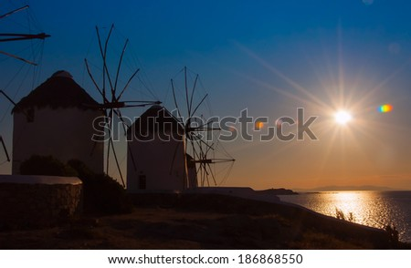 A number of famous windmills on the island of Mykonos at sunset. - stock photo