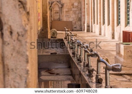 A number of tap water for ritual ablutions near the wall of the Muslim shrine - the mosque of Al-Aqsa. Jerusalem.