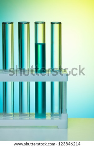 A number of test tubes on blue background in the lab - stock photo