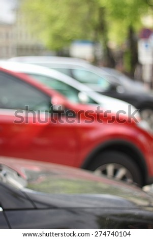 A number of the car. Blur, refocus, bokeh. A lot of cars in a row. To Park, drive. Cars in the city. On the street. Spring. Urban traffic. - stock photo