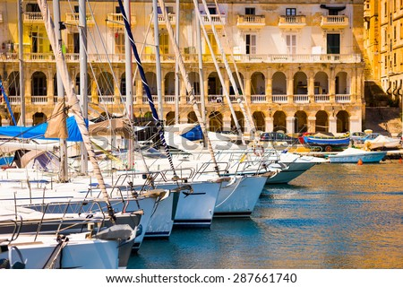 a number of yachts in a bay near Valletta in Malta - stock photo