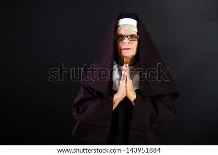 A nun in prayer - stock photo
