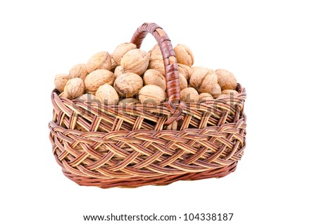 a nut in basket, isolated on white