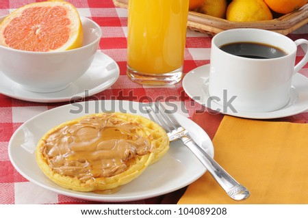 a nutritious breakfast with waffles and pink grapefruit - stock photo