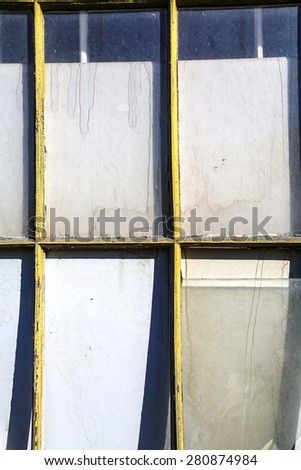A old and broken window in a abandoned building.