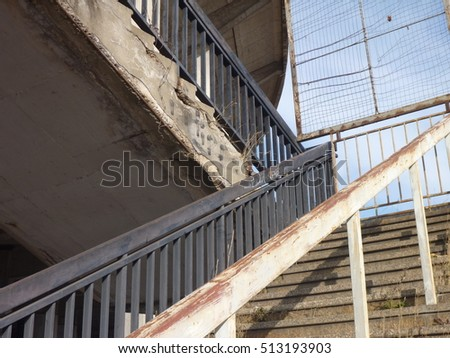 a old concrete outdoor staircase with steel railing
