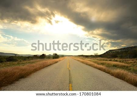 A old hwy travels through the southern Texas desert near San Antonio - stock photo