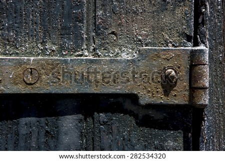 a old iron metal lock screw and wood in the centre of colonia del sacramento uruguay - stock photo