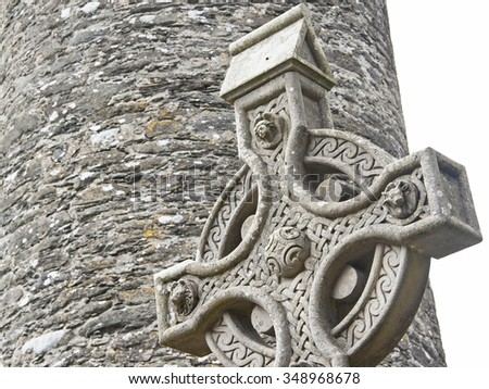 A old stone celtic cross in an irish graveyard, this cross is a traditional religious symbol in Ireland - stock photo