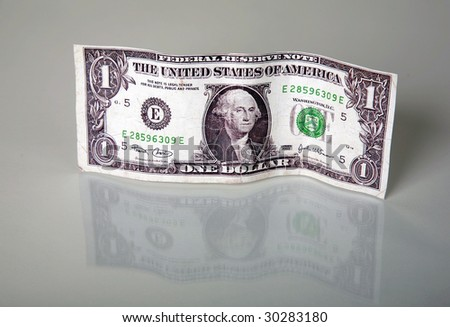 a one dollar bill with a reflection