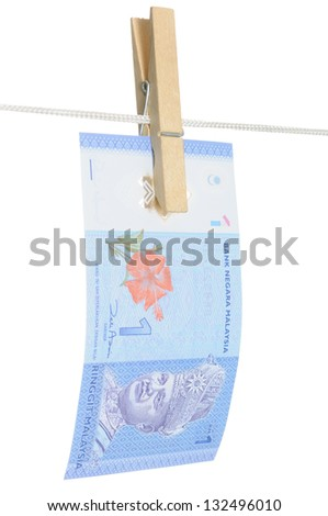A One Ringgit Malaysia note hung with a wooden cloth peg to symbolize money laundering activity