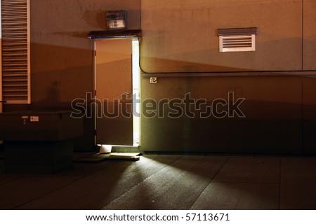 A open door in the darkness night. - stock photo
