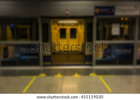 A opened sliding mechanical door of the Underground train at a tube station waiting for passenger.with blur - stock photo
