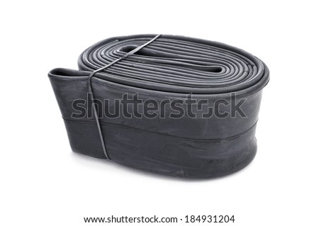 a packed bicycle inner tube on a white background - stock photo