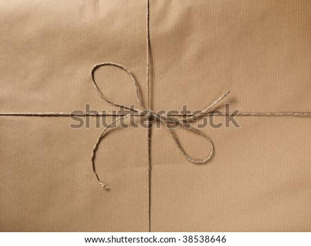 A packet closed with a string and bow. - stock photo