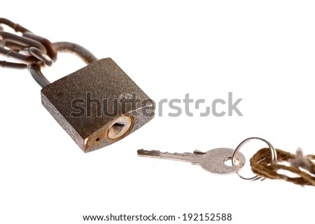 A padlock and a key, isolated on white.