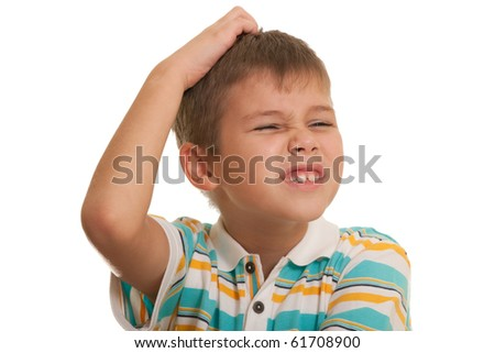 A painful face of a boy with a headache; isolated on the white background - stock photo