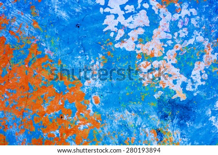 A paint daubed wall with cracked, aged areas provide a nice, saturated grunge background for placement of copy.W - stock photo