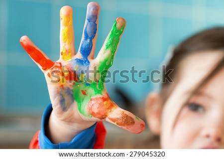 A painted hand of a little girl - stock photo
