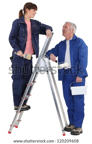 A painter and his apprentice. - stock photo