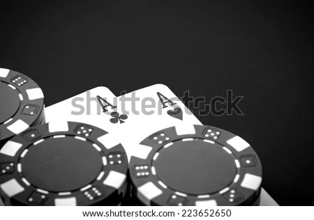 A pair of aces and chips on a casino table - stock photo