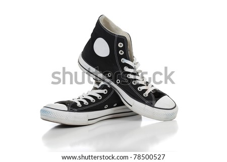 A pair of black retro hightop tennis shoes on a white background