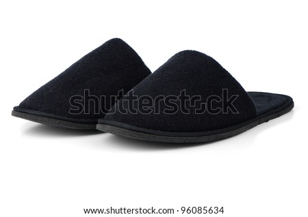 A pair of black slippers on a white background. - stock photo