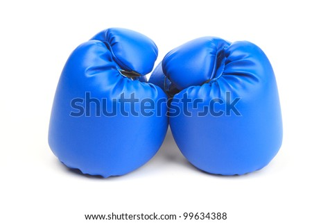 A pair of blue boxing gloves on white background - stock photo