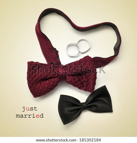 a pair of bow ties, one of them forming a heart, wedding rings and the sentence just married on a beige background, with a retro effect - stock photo