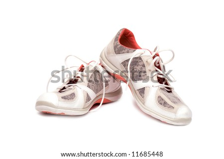 A pair of brand new running shoes, all logos and brand markings removed. - stock photo
