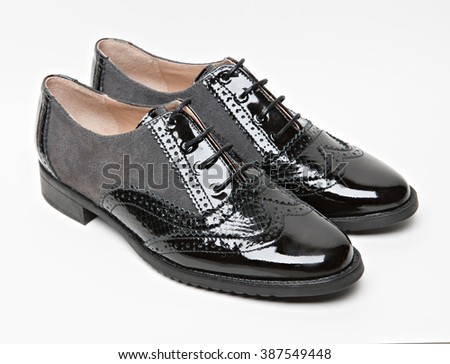 a pair of brogues shoes isolated with shadows