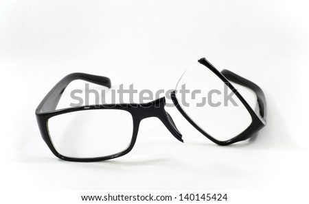 A pair of broken eyeglasses - stock photo