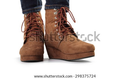 A pair of brown women boots standing, isolated on white background