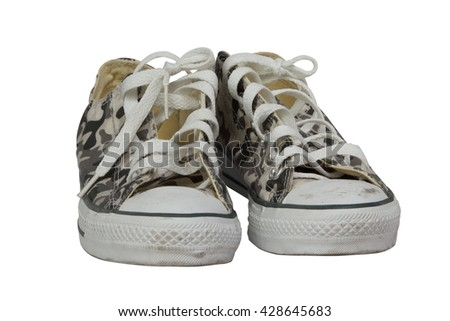 A pair of camouflage sneakers against white background