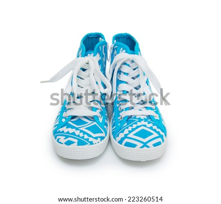 A pair of casual style gumshoes isolated on white background. - stock photo