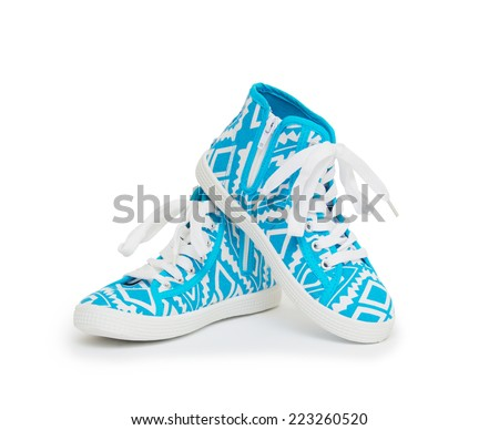 A pair of casual style gumshoes isolated on white background.