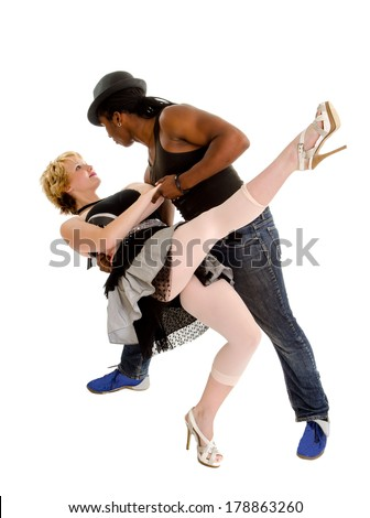 A Pair of Dancers Show the Passion and Love of the Tango - stock photo