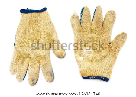 A pair of dirty gloves isolated on white - stock photo