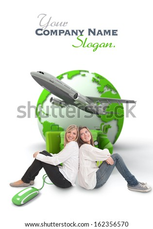 A pair of female friends with an online international travel booking background - stock photo