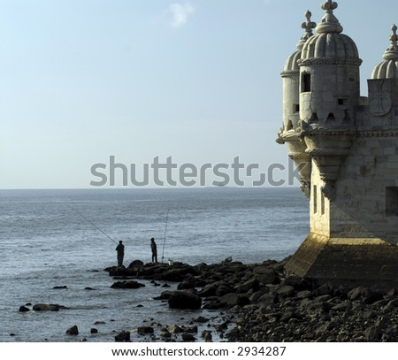 A Pair of fishermen enjoy a lovely sunny day in Portugal